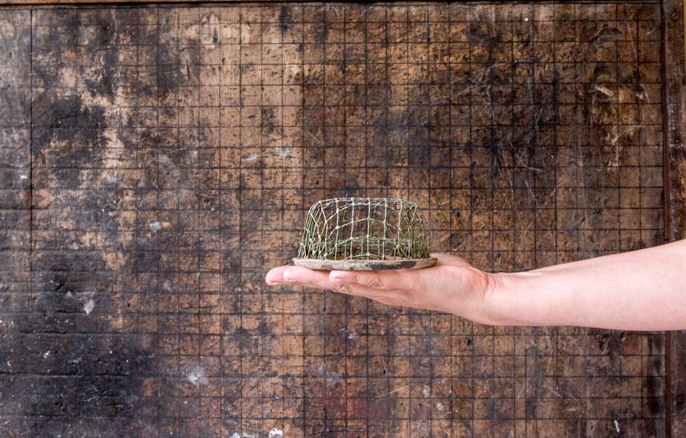 holding vintage cage flower frog